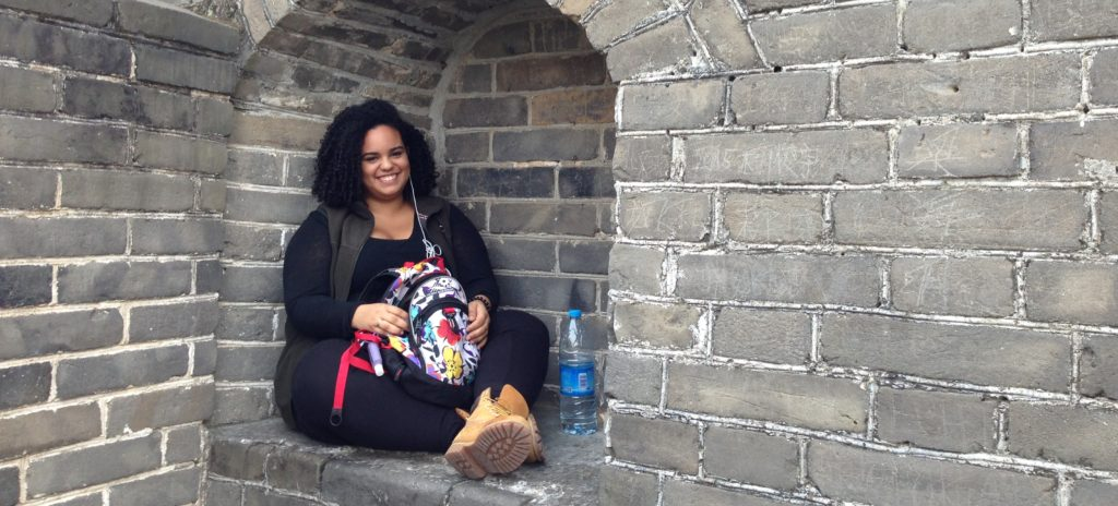 Girl sitting on wall