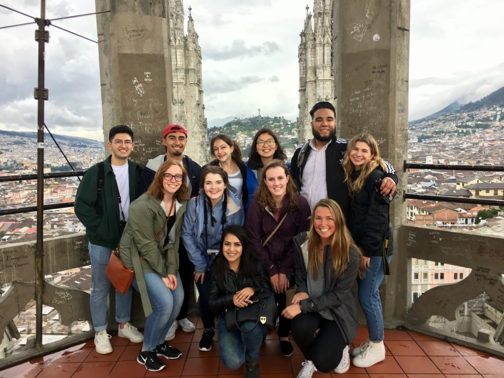 Group of students in front of city skyline