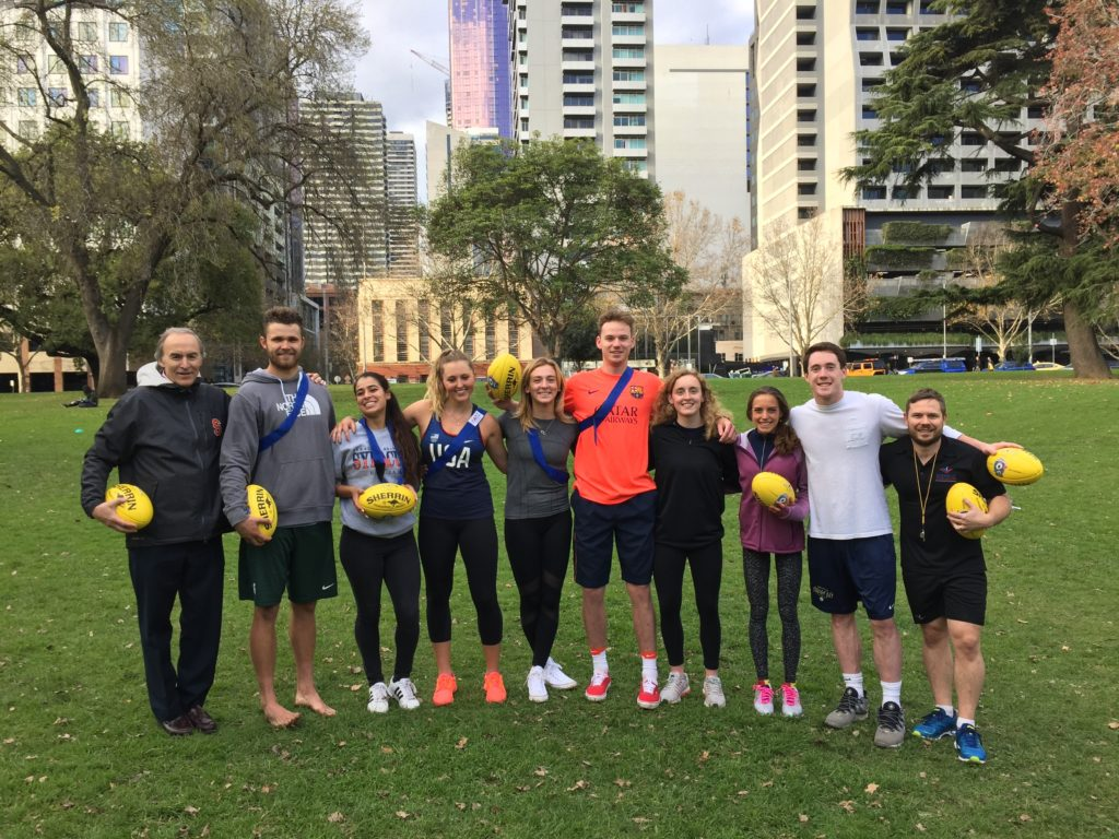 Group holding rugby balls in Australia