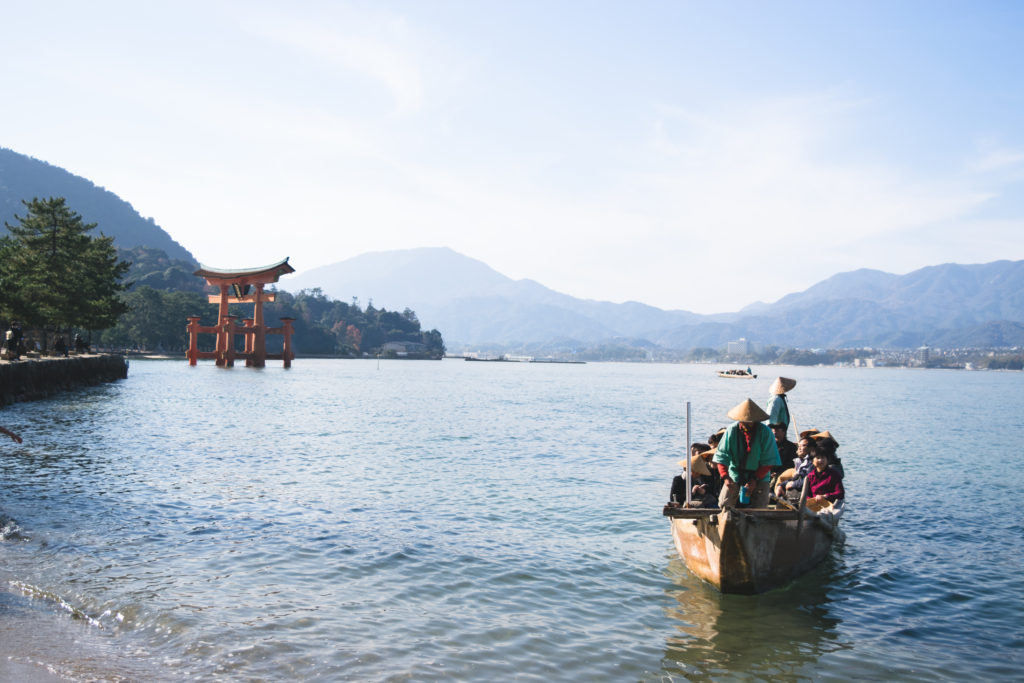 People in boat on water in Japan