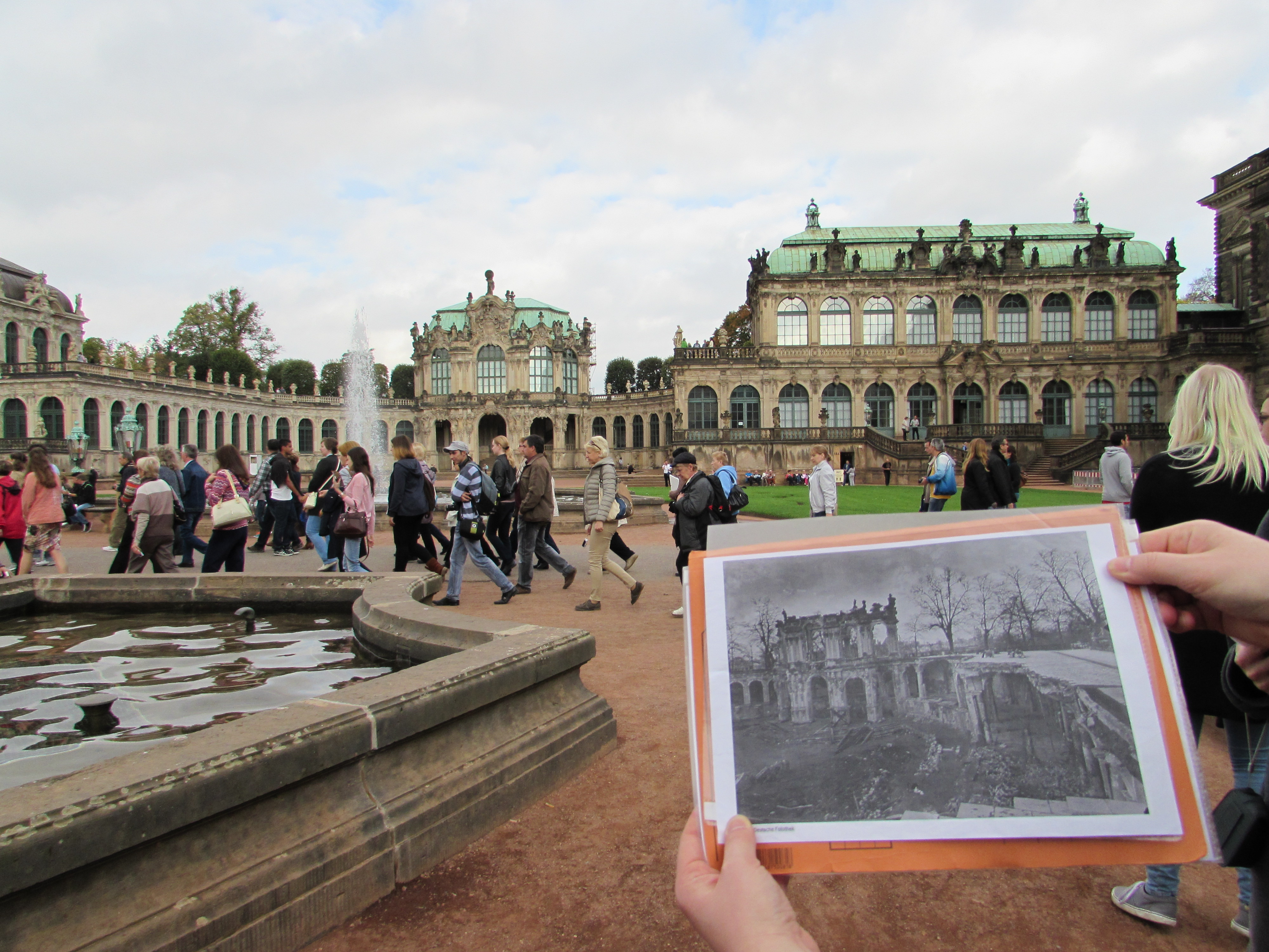 Student compares old photograph to current landscape