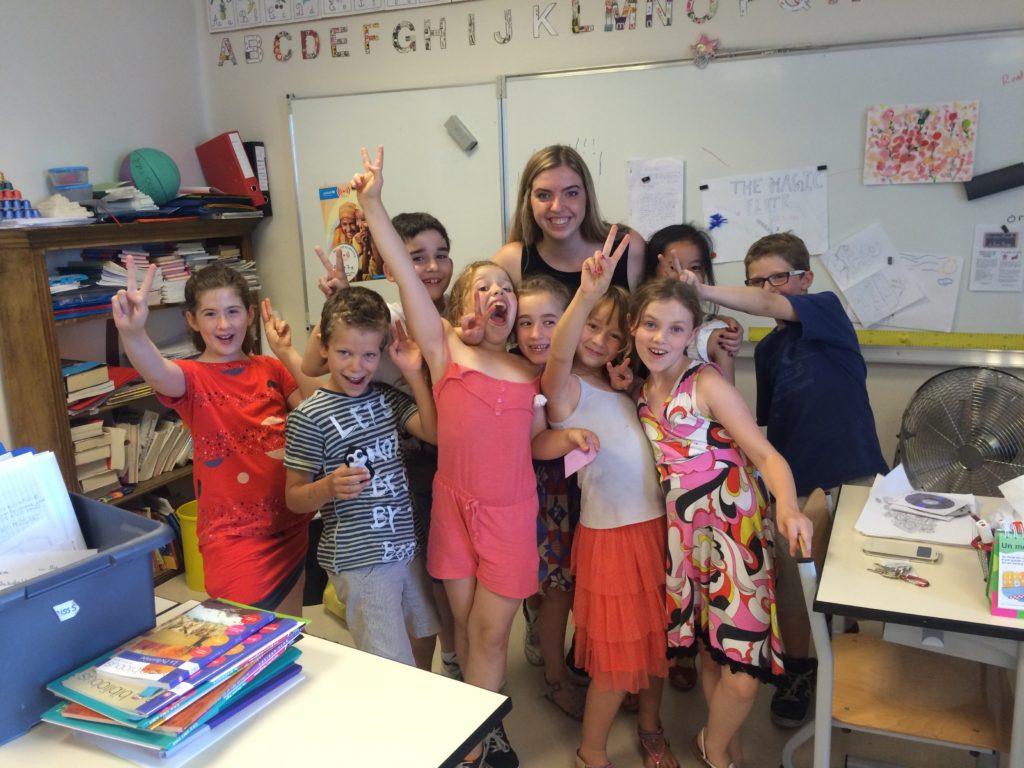Syracuse student with schoolchildren
