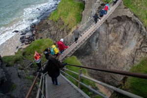 students on the Borders Seminar cross the Carrick-a-Rede rope bridge in Northern Ireland
